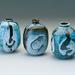 three stoneware jars